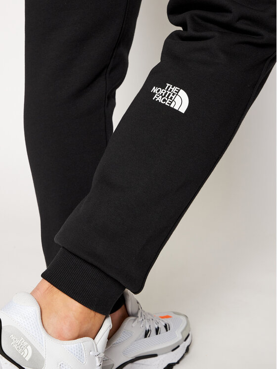 The North Face The North Face Spodnie dresowe Cot NF0A4CE4JK31 Czarny Regular Fit
