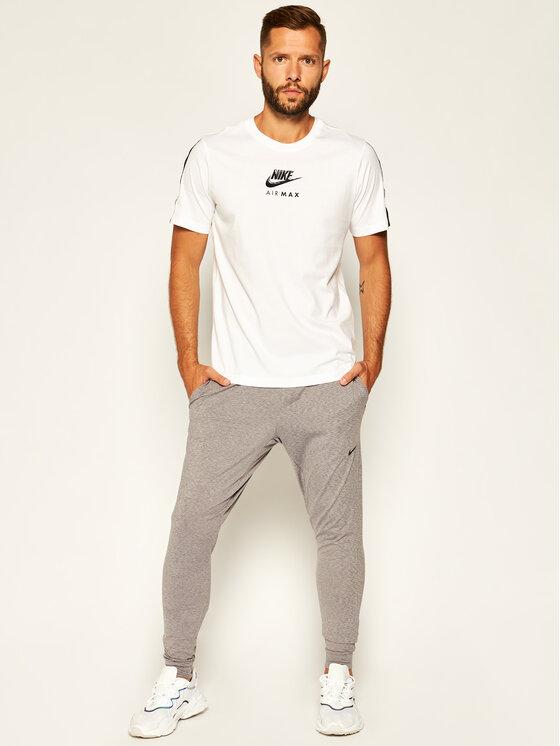 Nike Nike Spodnie dresowe Dri-FIT Yoga AT5696 Szary Standard Fit