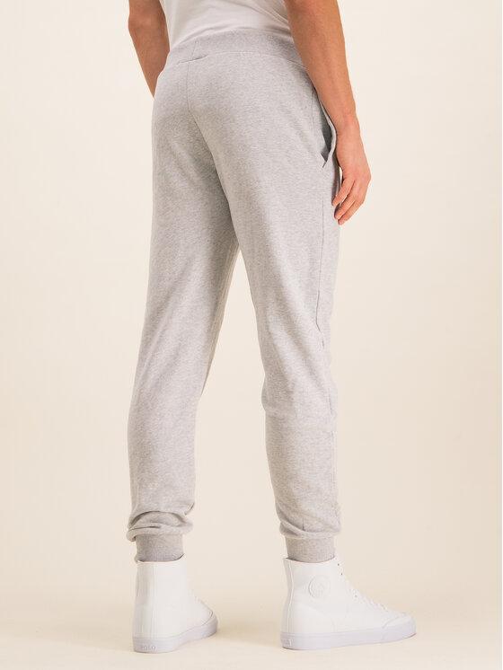 Guess Guess Spodnie dresowe U01Q01 FL038 Szary Regular Fit