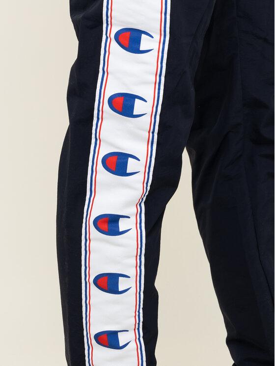 Champion Champion Pantaloni da tuta C Logo Tape Track 214047 Blu scuro Regular Fit