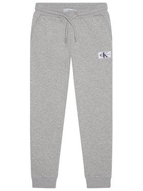 Calvin Klein Jeans Calvin Klein Jeans Teplákové kalhoty Monogram IB0IB00519 Šedá Regular Fit