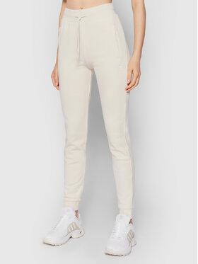 adidas adidas Spodnie dresowe adicolor Essentials H37873 Beżowy Slim Fit