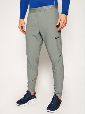 NIKE NIKE Spodnie dresowe Flex CJ2218 Szary Standard Fit