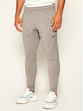 NIKE NIKE Jogginghose Dri-FIT Yoga AT5696 Grau Standard Fit