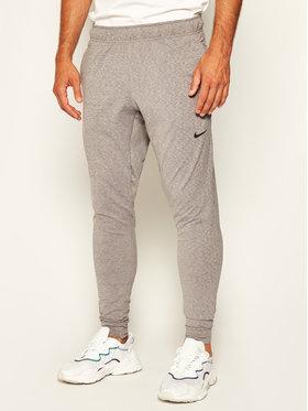 NIKE NIKE Pantaloni da tuta Dri-FIT Yoga AT5696 Grigio Standard Fit