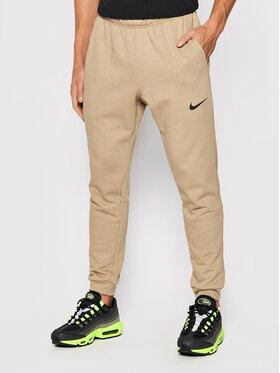 Nike Nike Melegítő alsó Dri-Fit CZ6379 Barna Slim Fit