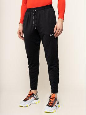NIKE NIKE Spodnie dresowe Therma BV4813 Czarny Standard Fit