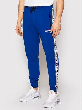 Guess Guess Spodnie dresowe U0BA34 K6XF0 Niebieski Regular Fit