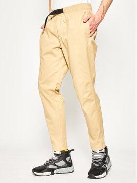 New Balance New Balance Текстилни панталони Athletics Woven MP01504 Кафяв Athletic Fit