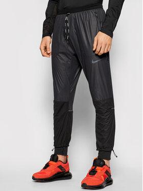 Nike Nike Teplákové nohavice Swift Shield CU7857 Čierna Regular Fit