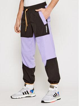 adidas adidas Долнище анцуг Adventure Colorblock GN2368 Виолетов Regular Fit