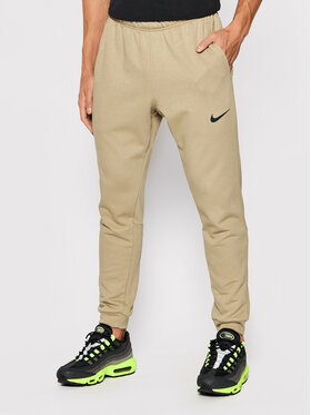 Nike Nike Spodnie dresowe Dri-Fit CZ6379 Brązowy Slim Fit