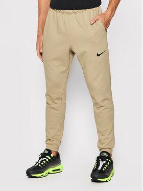 Nike Nike Teplákové nohavice Dri-Fit CZ6379 Hnedá Slim Fit