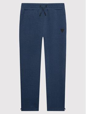 Guess Guess Spodnie dresowe L1BQ15 JR06S Granatowy Regular Fit