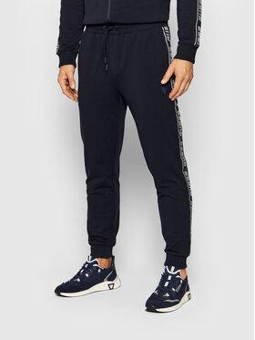 Guess Guess Spodnie dresowe U1GA11 K6ZS1 Granatowy Slim Fit