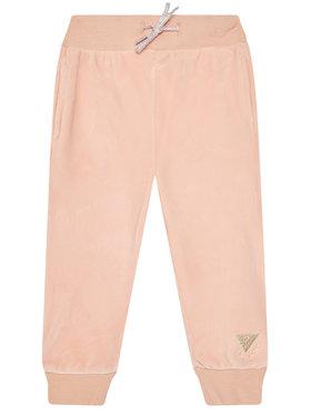 Guess Guess Spodnie dresowe K0BQ04 KA2X0 Pomarańczowy Regular Fit