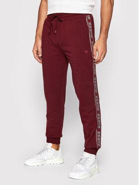 Guess Guess Spodnie dresowe U1GA11 K6ZS1 Bordowy Regular Fit