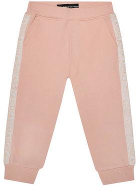 Guess Guess Spodnie dresowe K0YQ02 KA6V0 Różowy Regular Fit