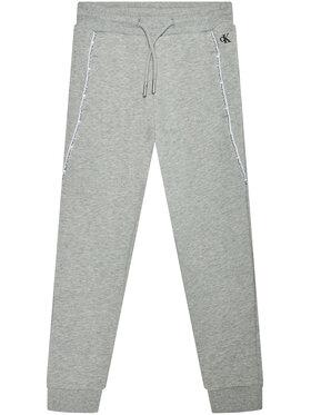 Calvin Klein Jeans Calvin Klein Jeans Teplákové kalhoty Logo Piping IB0IB00711 Šedá Regular Fit