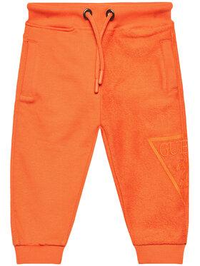 Guess Guess Teplákové kalhoty N1RQ09 KA6R0 Oranžová Regular Fit