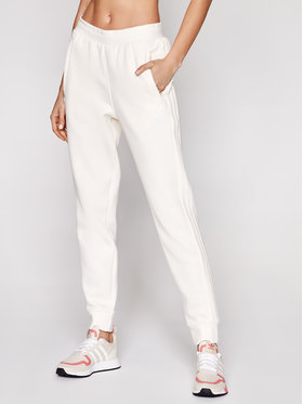 adidas adidas Spodnie dresowe adicolor 3-Stripes GN3456 Beżowy Slim Fit