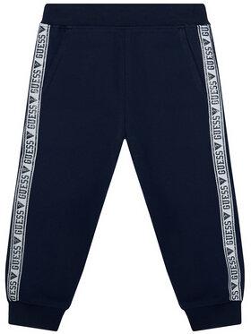 Guess Guess Spodnie dresowe K0YQ02 KA6V0 Granatowy Regular Fit