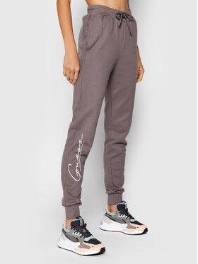 Guess Guess Spodnie dresowe O1BA11 KAOR1 Fioletowy Regular Fit