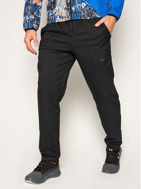 NIKE NIKE Teplákové kalhoty Dri-FIT CU4957 Černá Standard Fit